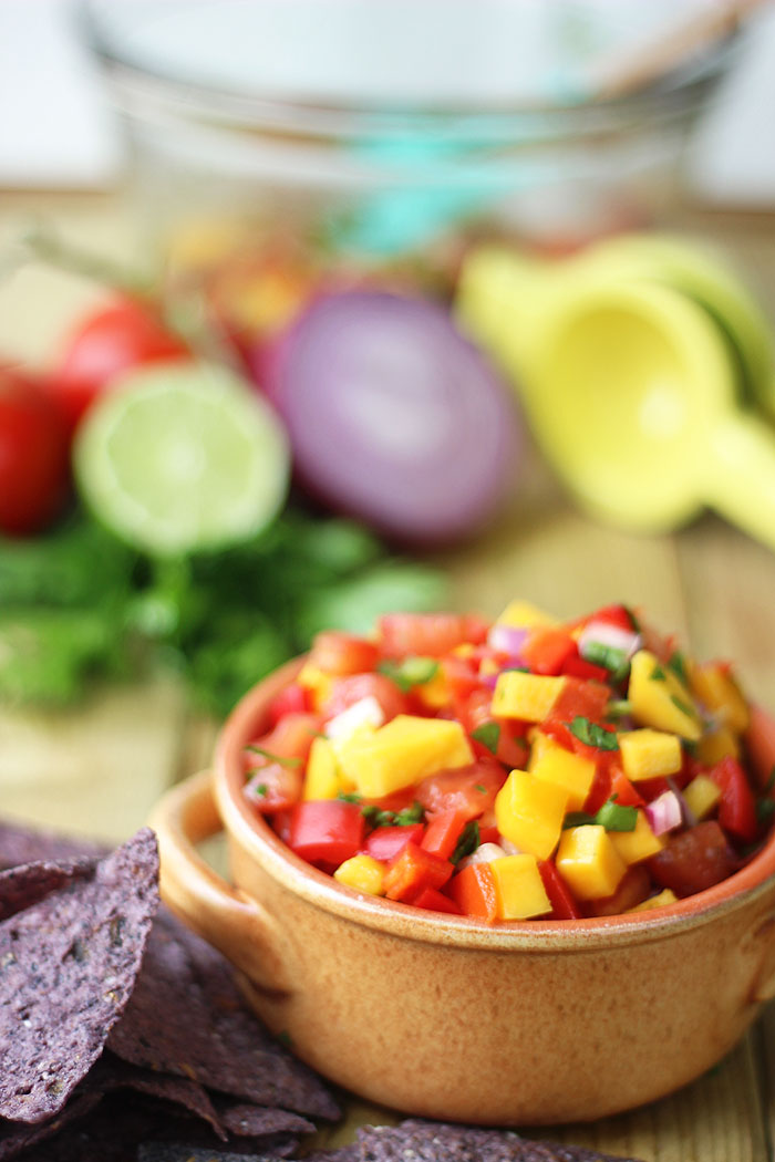 A spicy sweet and savoury mango salsa dip that makes the perfect snack, perfect side for a summer BBQ.