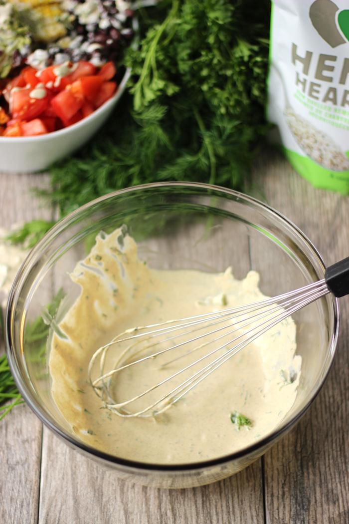 A healthy taco salad bowl with a creamy ranch hemp dressing.