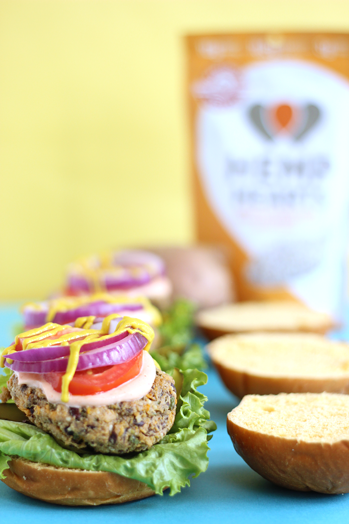 Hearty and flavourful, these veggie burgers are made from black beans, sweet potatoes, mushrooms, and Hemp Hearts to make the perfect patties for your summer grill.