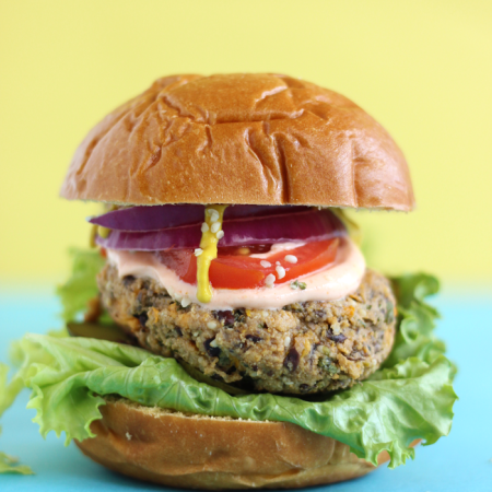 Sweet potato and black bean burger on a blue table in front of a yellow wall