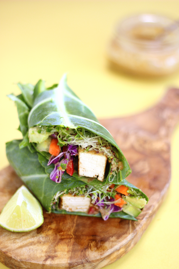 Grilled Tofu in a collard green wrap filled with crunchy sweet veggies and drizzled with a sweet and savoury Thai almond sauce.