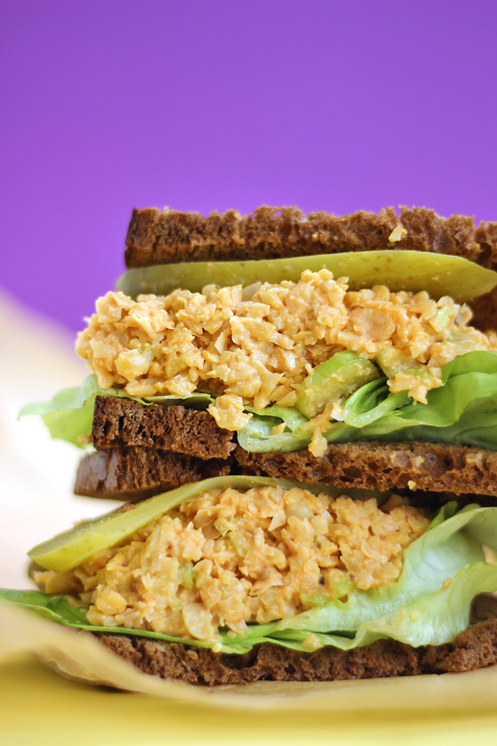 This Buffalo Chickpea Salad Sandwich is packed with fiber, plant based protein and finished off with a hot spicy kick. It's guaranteed to become your next brown bag lunch staple.