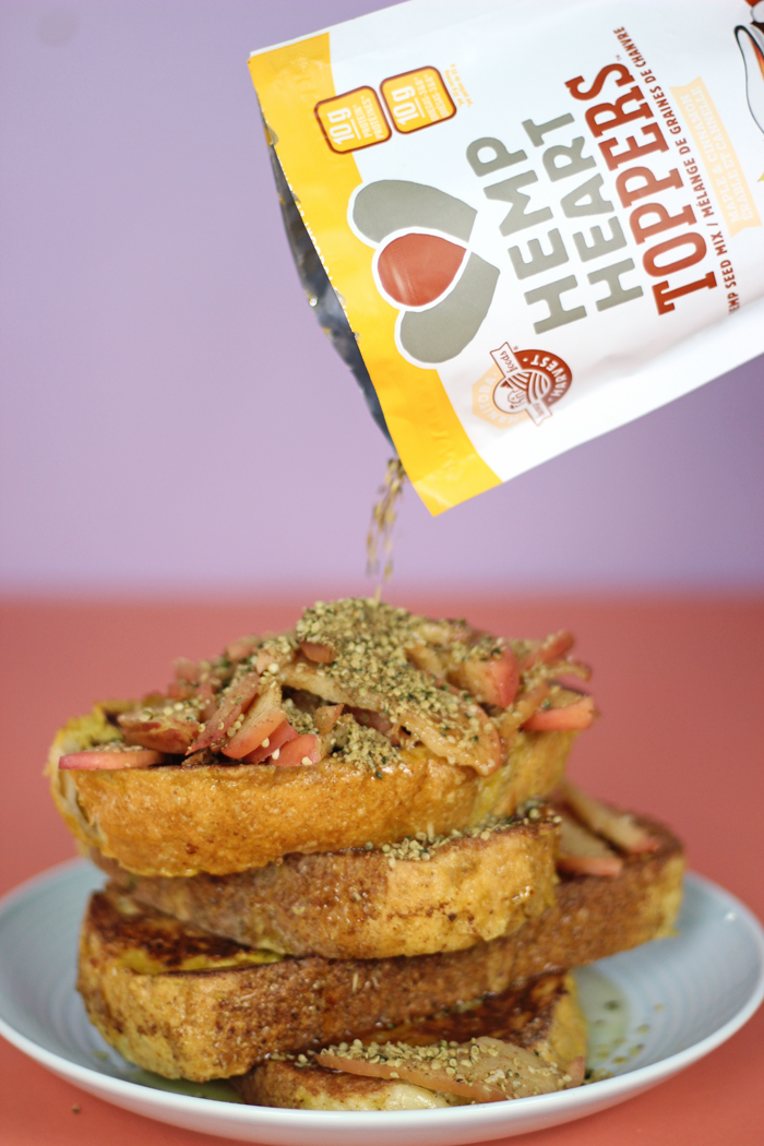 Super Easy Fall inspired Apple Cinnamon French Toast! Soft sourdough bread spiced with sweetness and cinnamon, topped with caramelized apples and Manitoba Harvest Hemp Hearts. Healthy, nutritious, and absolutely delicious.