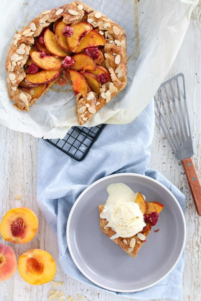 A rustic Peach Raspberry Galette filled with juicy peaches and tart raspberries, for the perfect end of summer dessert & the easiest pie you will ever make!