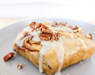 These warm, gooey, soft, homemade cinnamon rolls drizzled in the most delicious refined sugar-free glaze are the perfect treat for breakfast and dessert this holiday season!