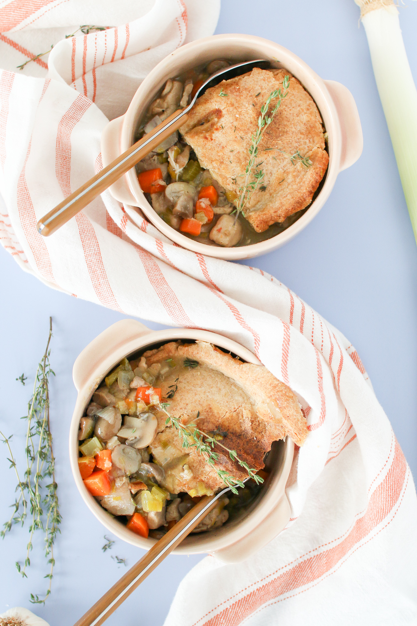 This seriously delicious homemade chicken pot pie loaded with mushrooms and leeks, topped with a flaky spelt flour pastry and fresh thyme, is the perfect comforting meal to enjoy on a cold and wintry night.