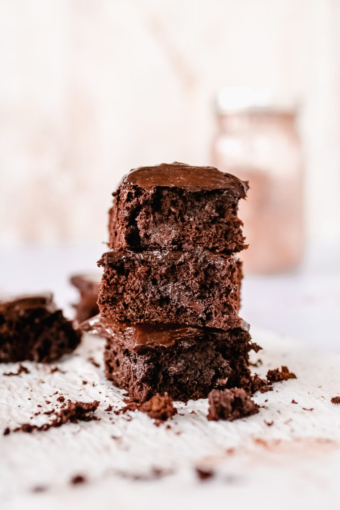 This gluten-free triple chocolate zucchini brownie slathered in chocolate avocado frosting is the ultimate decadent dessert but with a healthy twist.