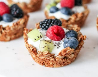 A healthy dessert for breakfast; granola cups made with wholesome ingredients and filled with your favourite yogurt and topped with fresh fruit.