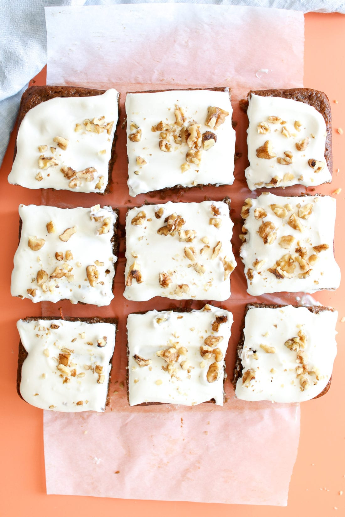 A healthy carrot cake, naturally sweetened with applesauce and maple syrup, loaded with freshly grated carrots, warming spices, topped with a honey cream cheese frosting and crunchy walnuts.