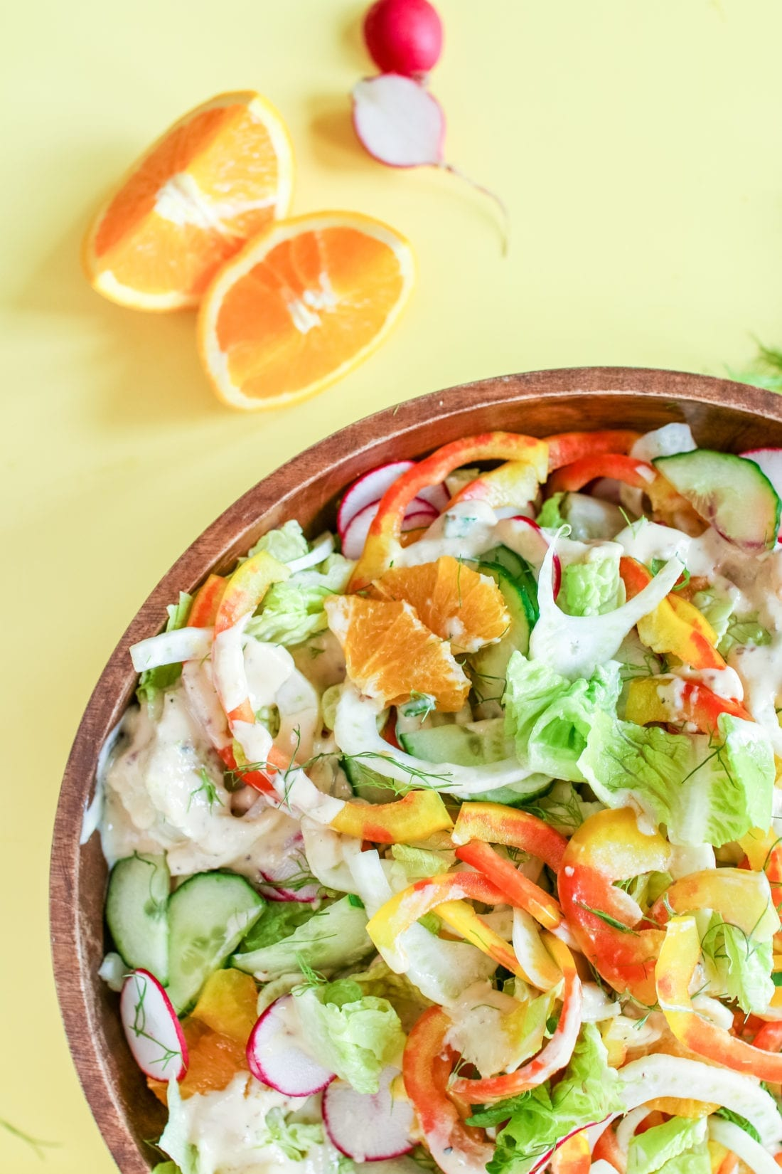 This Citrus Fennel Spring Salad with a creamy Orange Tahini dressing is packed full of fresh seasonal ingredients like crispy romaine, crunchy peppers and fennel - the ultimate spring and summertime salad.
