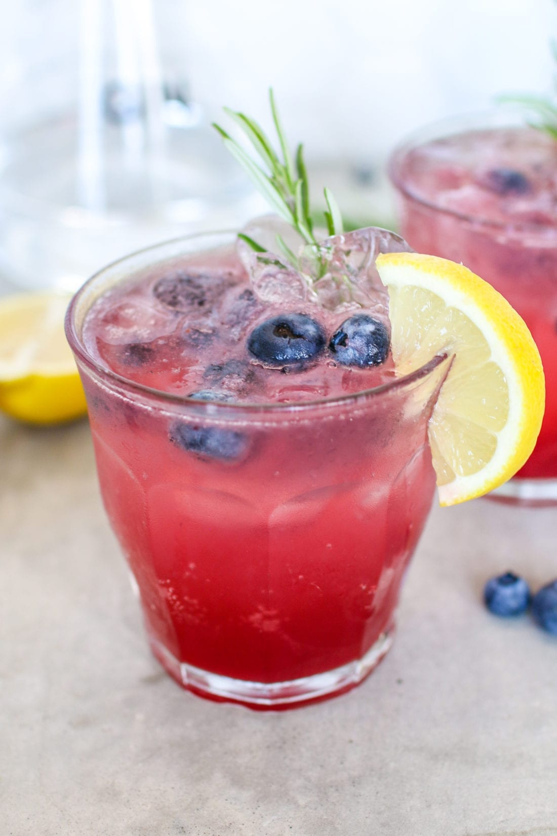 This refreshing cocktail packed full of fresh berries, fragrant rosemary and gin is the perfect summertime drink for your next dinner party and BBQ feast!