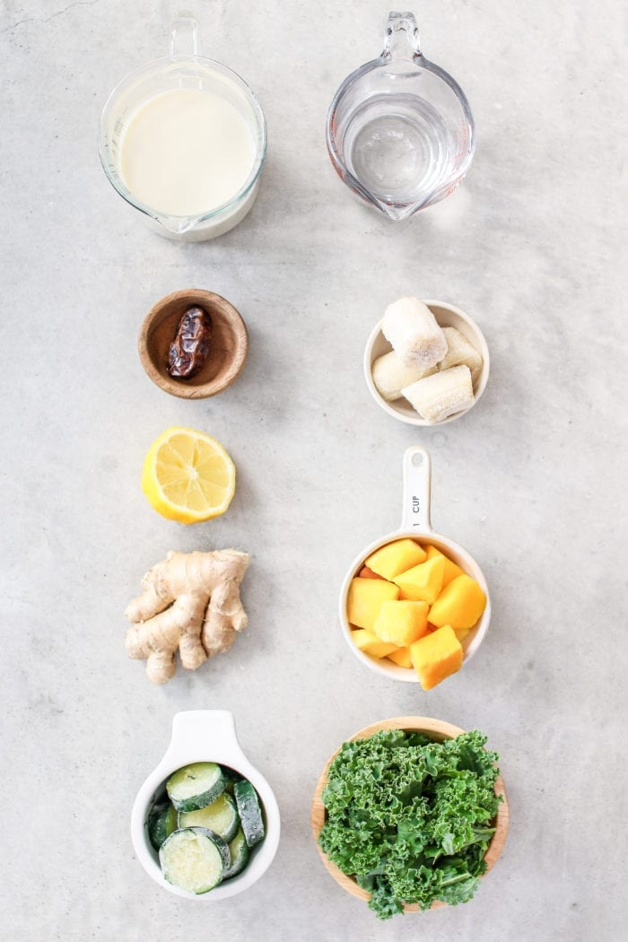 An immune-boosting green smoothie that's ready in less than 5 minutes and packed full of kale, zucchini, mango, banana, and zingy ginger!