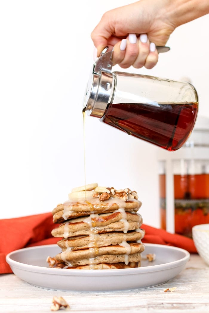 These simple and delicious, fluffy pancakes infused with warming chai spices and drizzled with a maple coconut butter glaze makes for a perfect cozy breakfast on a Sunday morning.