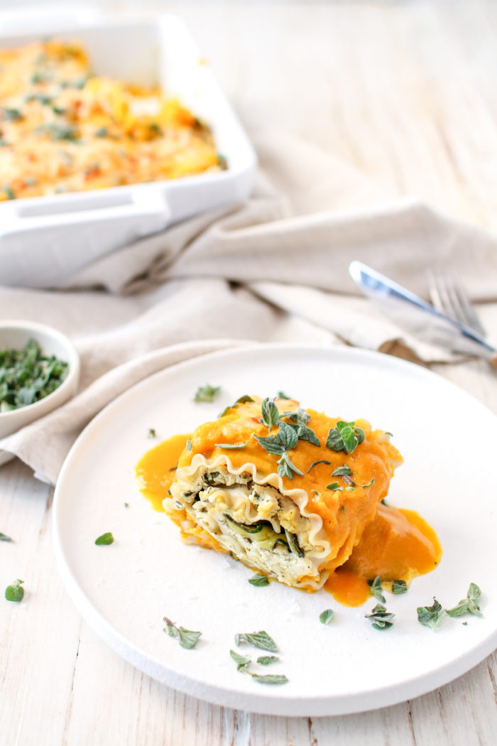 """These delicious and tasty Butternut Squash and Spinach Lasagna Roll Ups are stuffed with """"ricotta"""", spinach, zucchini and drowning in butternut squash purée. Perfect for any night of the week!"""
