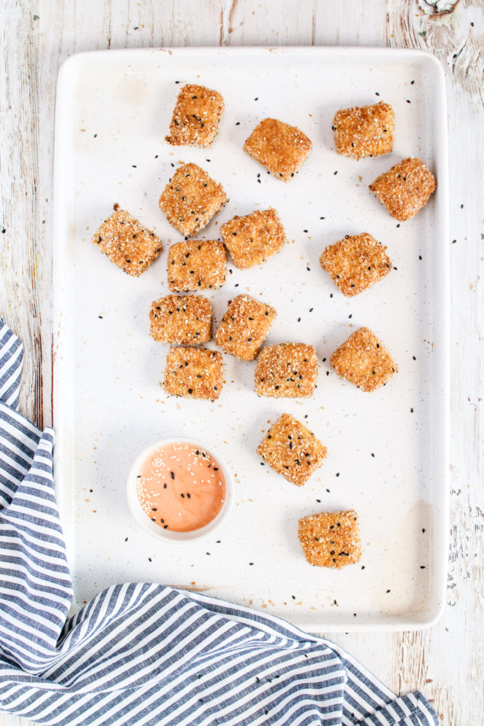 These gluten-free crispy baked tofu nuggets are crispy on the outside and tender on the inside. Dipped into your favourite sauce - it's the perfect bite-size dunkable appetizer or snack that everyone will love.