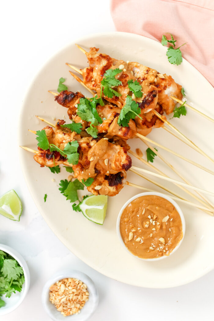 Takeout-inspired Chicken Satay with Peanut Sauce that is ready in 30 minutes. This easy and healthy weeknight meal is quicker than takeout, and just as delicious!