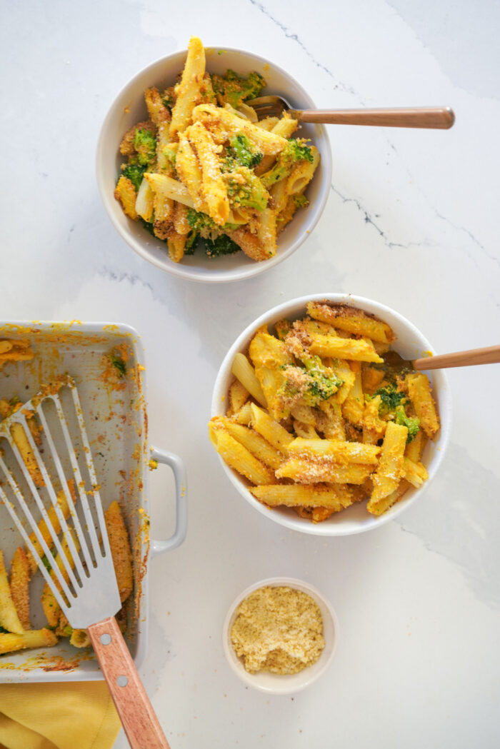 This is the best Dairy Free Baked Mac and Cheese with Broccoli recipe that is ready in just 35 minutes! It's made with a creamy dairy free squash sauce poured over noodles and broccoli. Sprinkled with a homemade breadcrumb topping and baked in the oven until crispy and golden brown. It's perfect for healthy weeknight dinners that the whole family will enjoy!