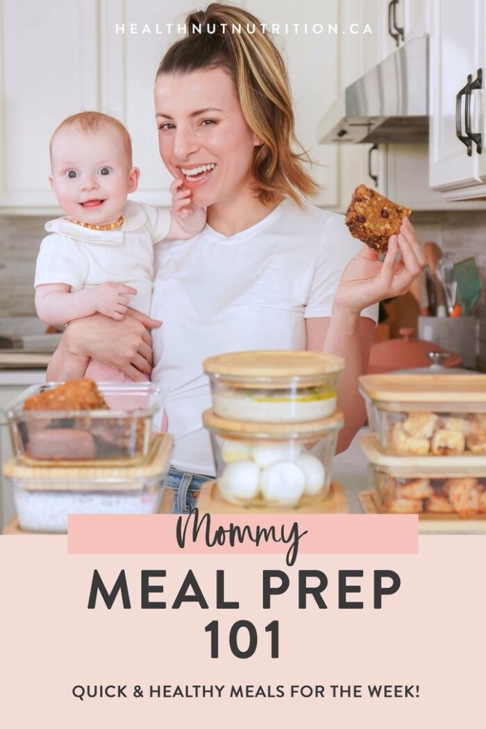 a mom holding her baby showing off her meal prepped food