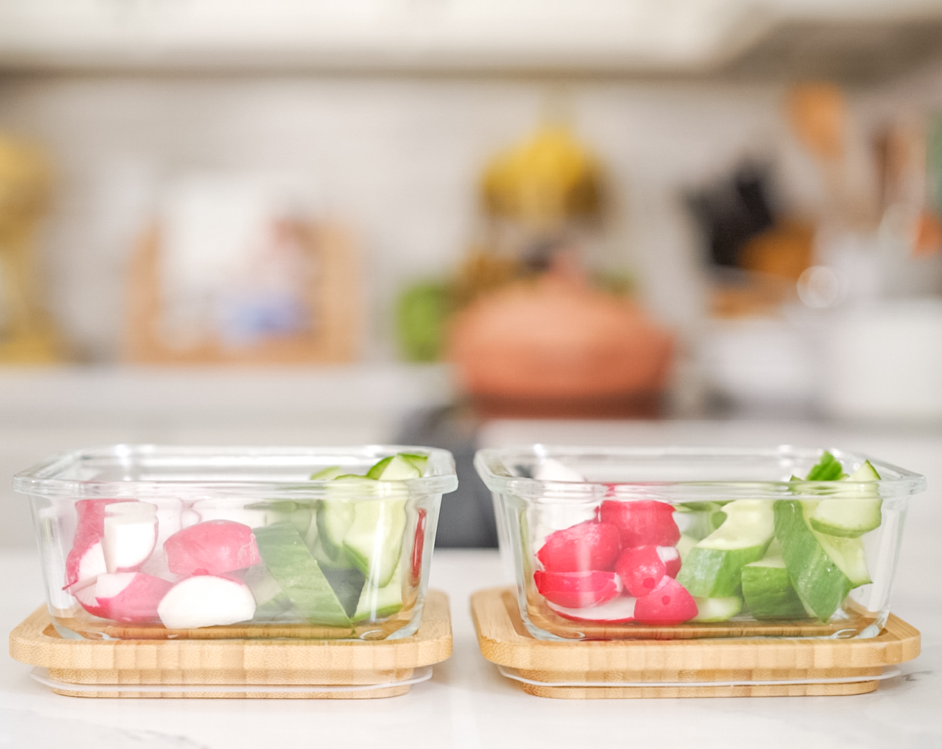 chopped up cucumber and radish to dip in hummus in glass containers