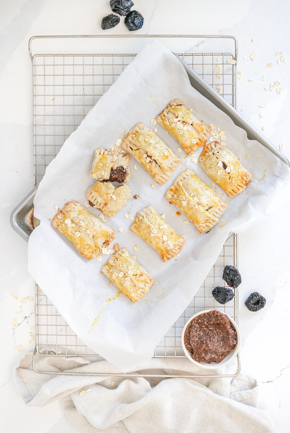 chia prune healthy energy bars laid out on a baking tray