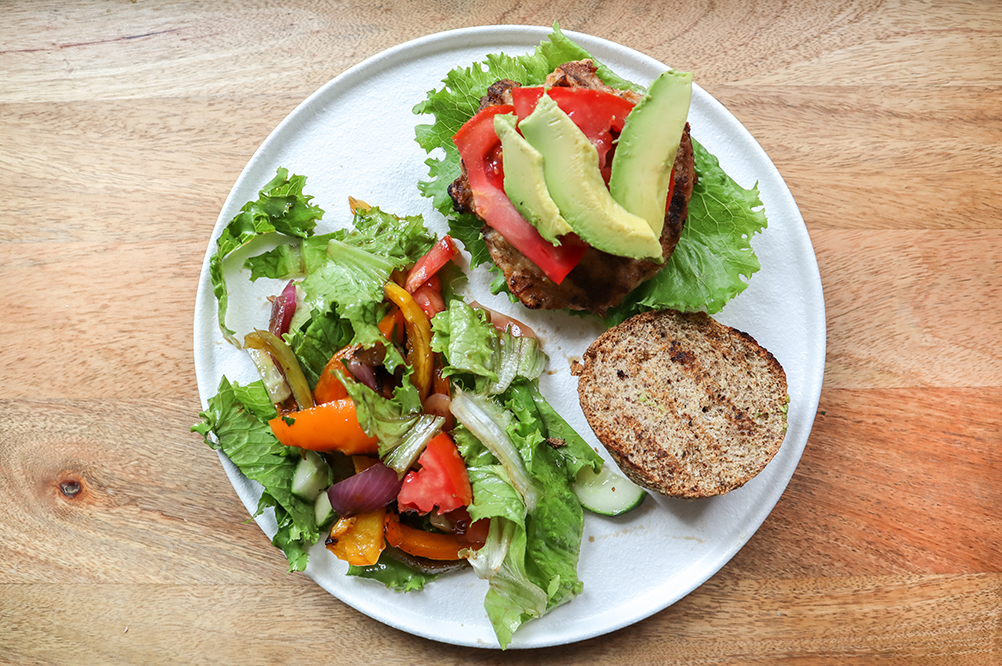 plate of chicken burgers with salad