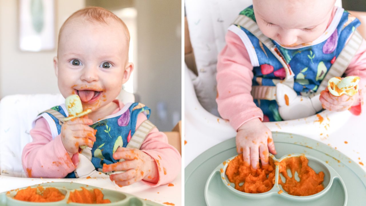 a 6 month old baby eating purees while wearing a blue bib