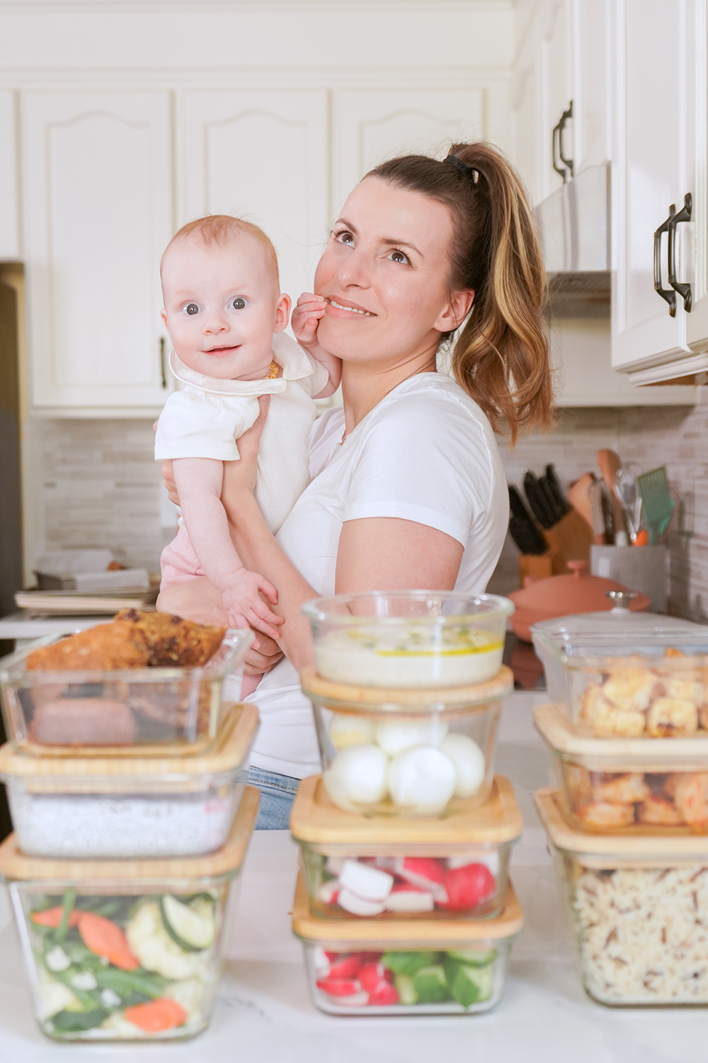 woman and baby in front of meal prepped food