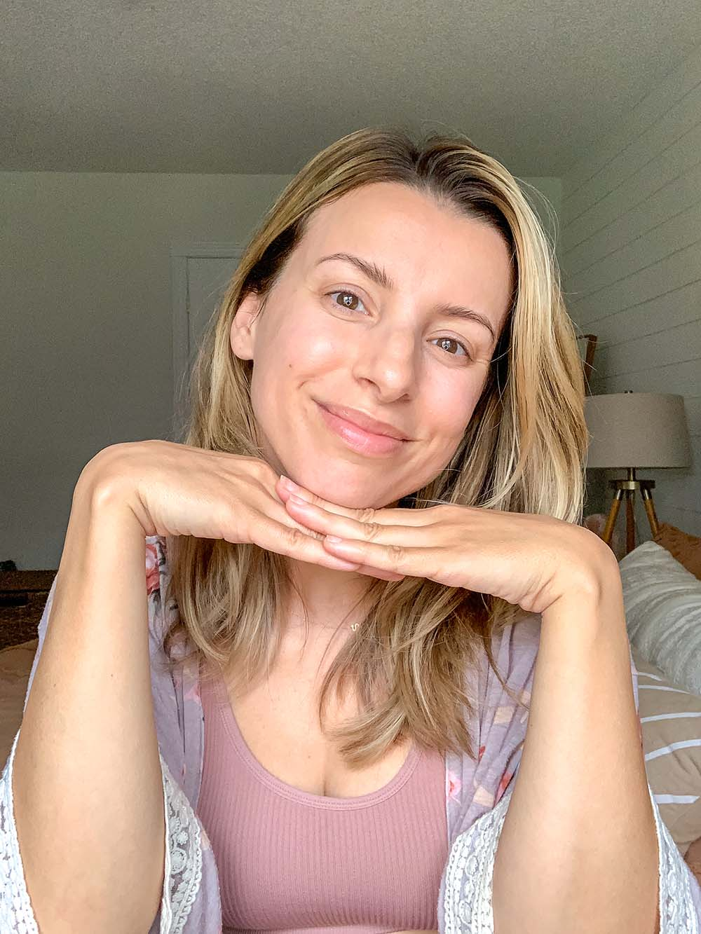 woman showing off her non toxic morning skincare routine